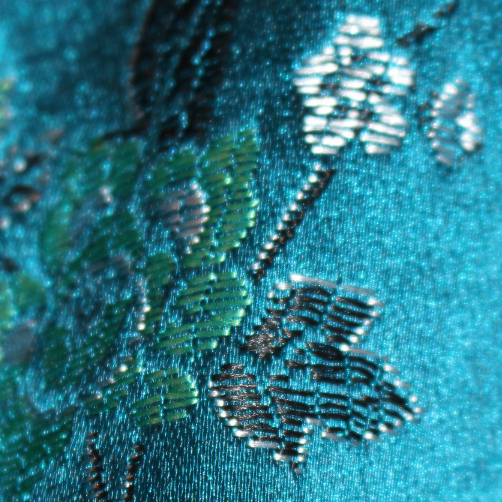 Blue Chinese silk top, showing detail of embroidery stitching