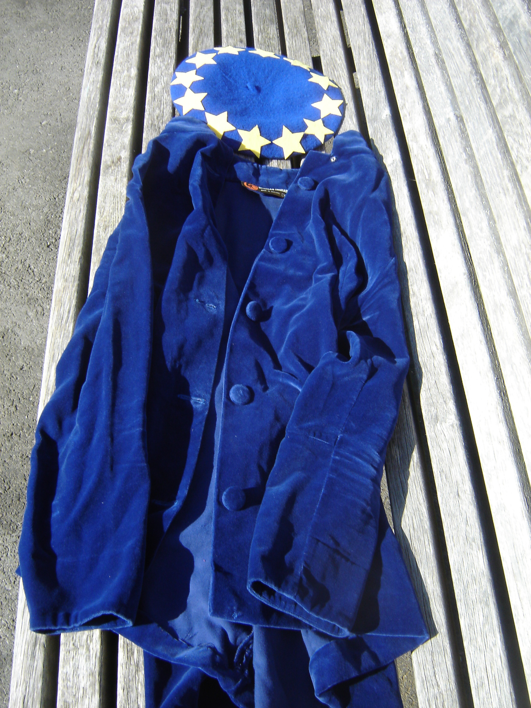 Dark blue EU beret with yellow stars, next to cropped velvet Charles Ingram jacket, almost the same colour