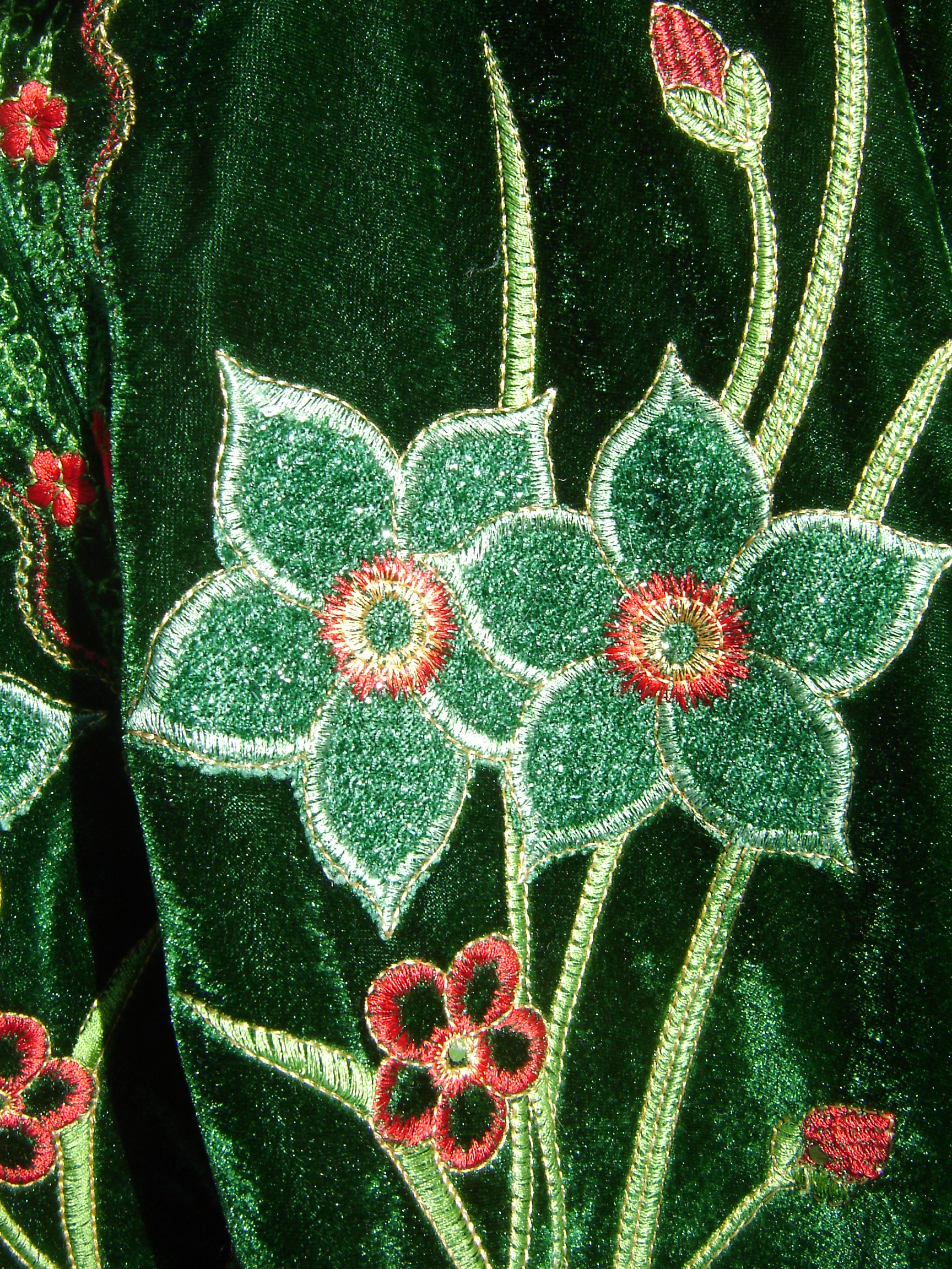 Green embroidered velvet flowered top, showing detail of embroidery