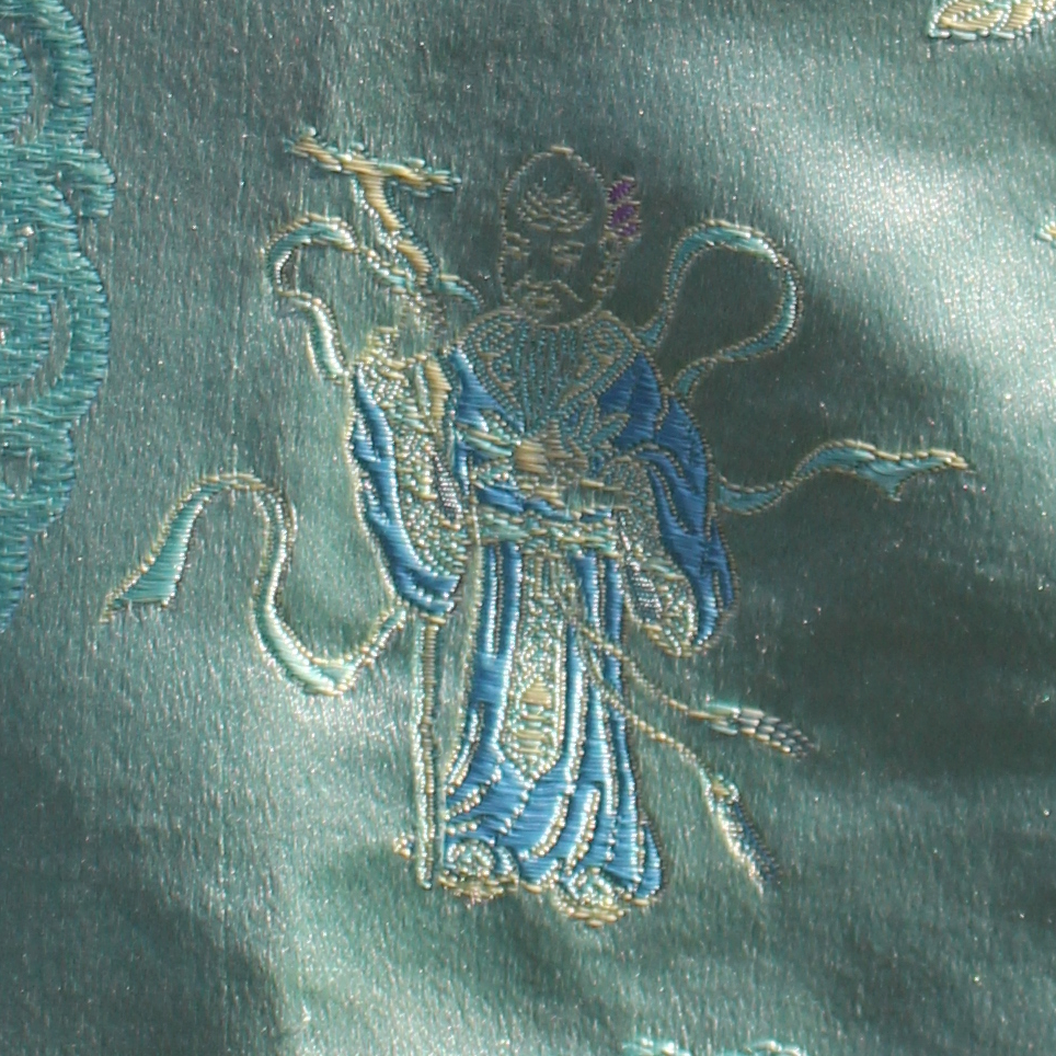 Green embroidered silk Chinese top, detail of embroidery