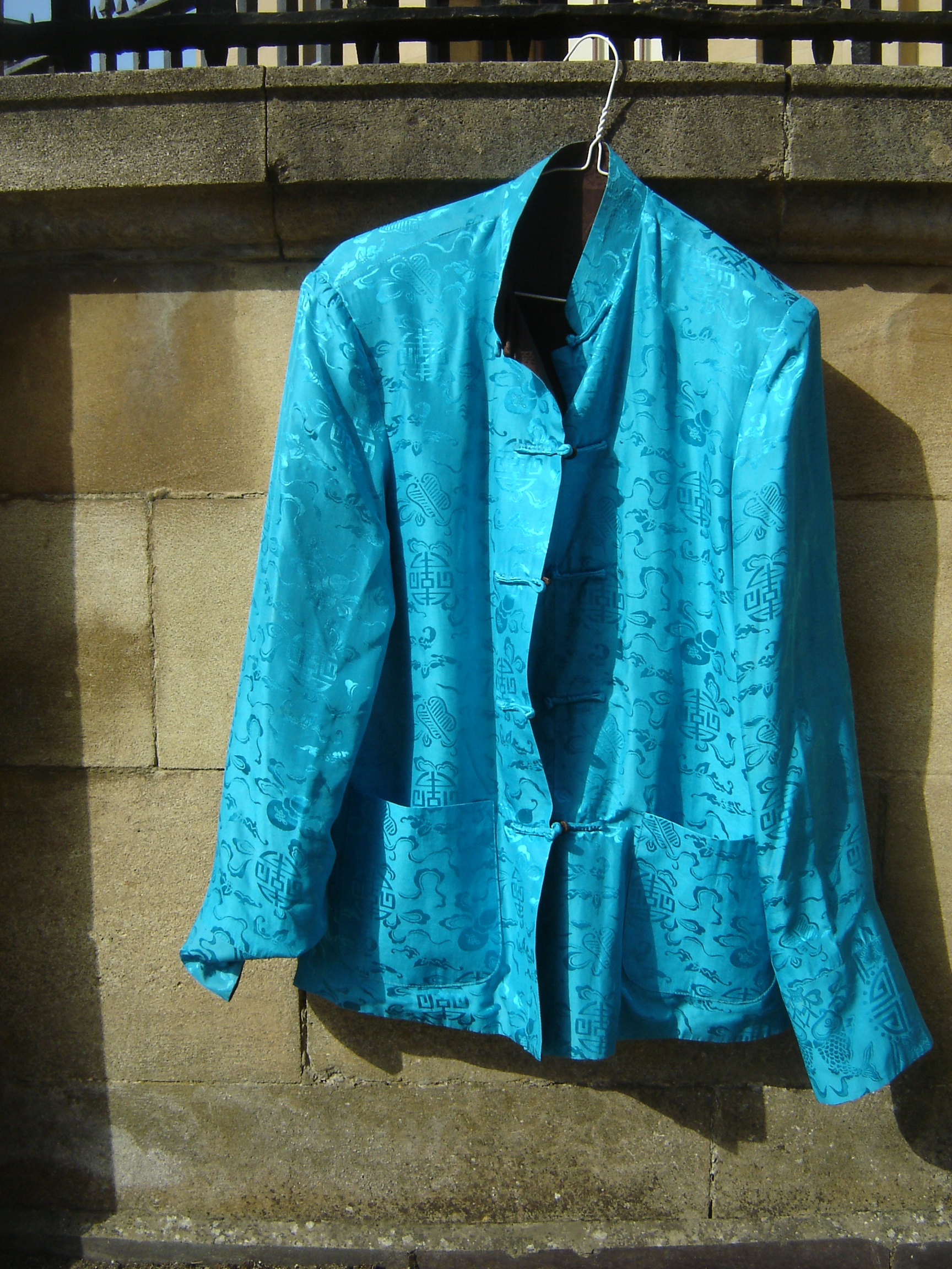 Intense blue and chocolate reversible silk Chinese jacket.