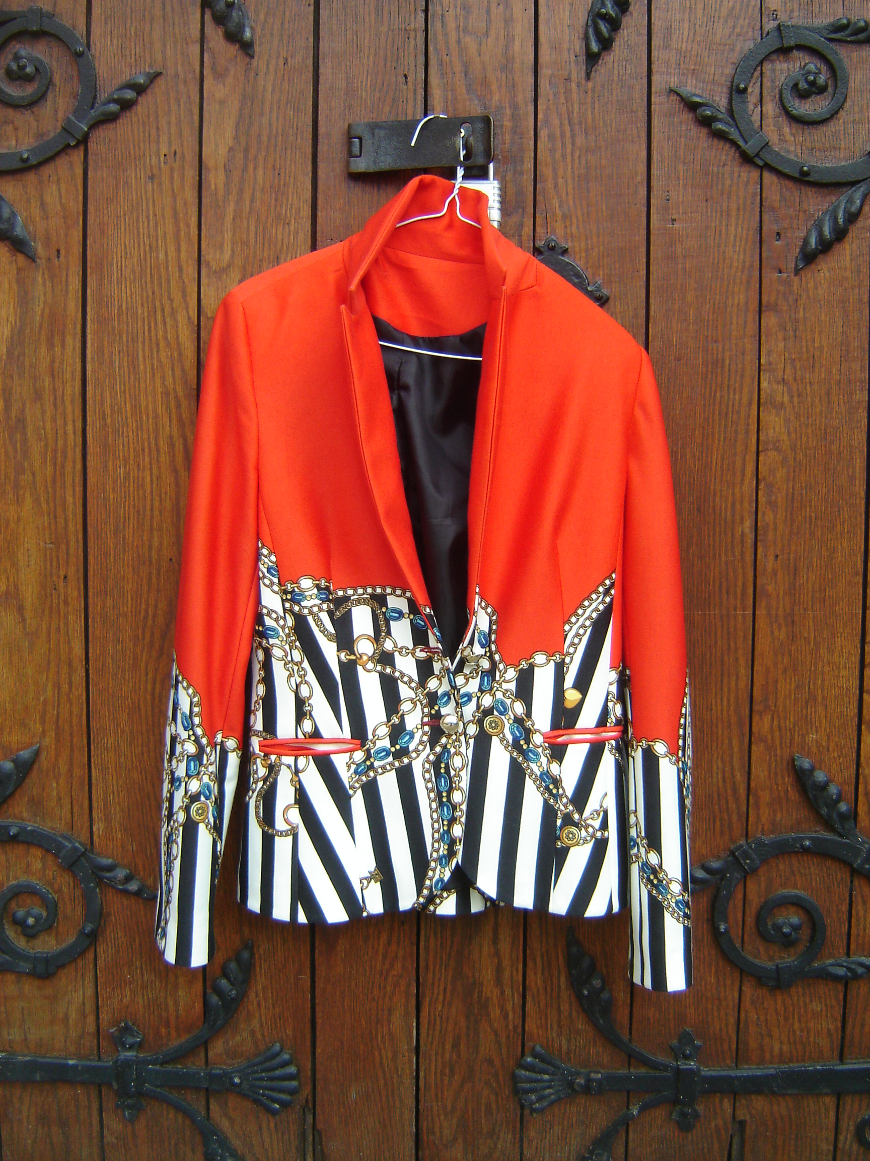 Red wool jacket with printed chain design.