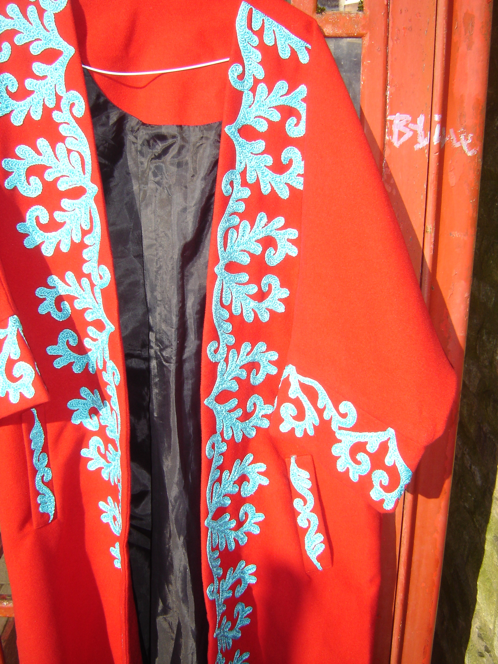 Splendid red full-length coat with turquoise embroidery