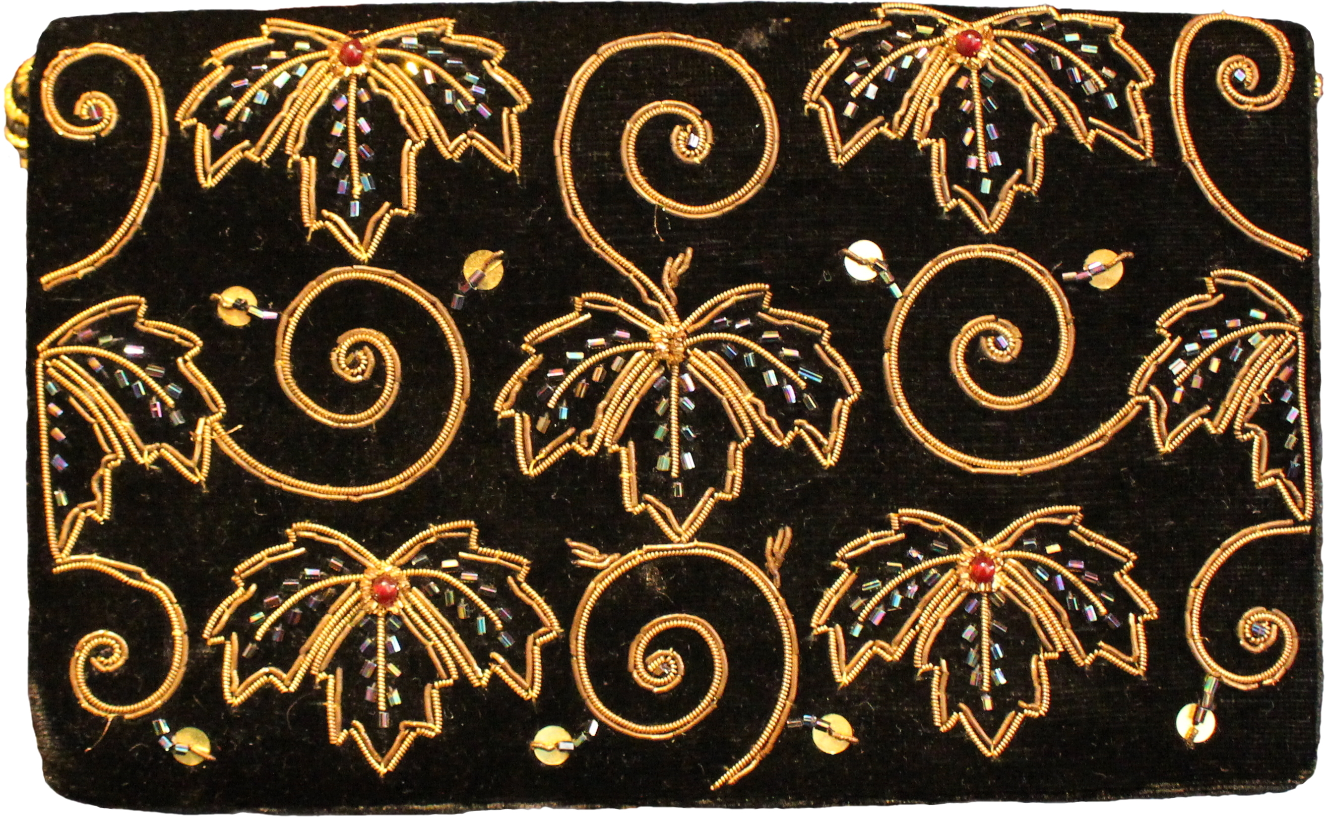 Black velvet evening bag. It's the size of a large purse, rectangular, and decorated with sequins, small plastic beads, and leaves and spirals made from metal segments.