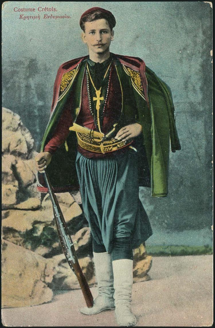 Postcard of man wearing Cretan costume, including vraka trousers.