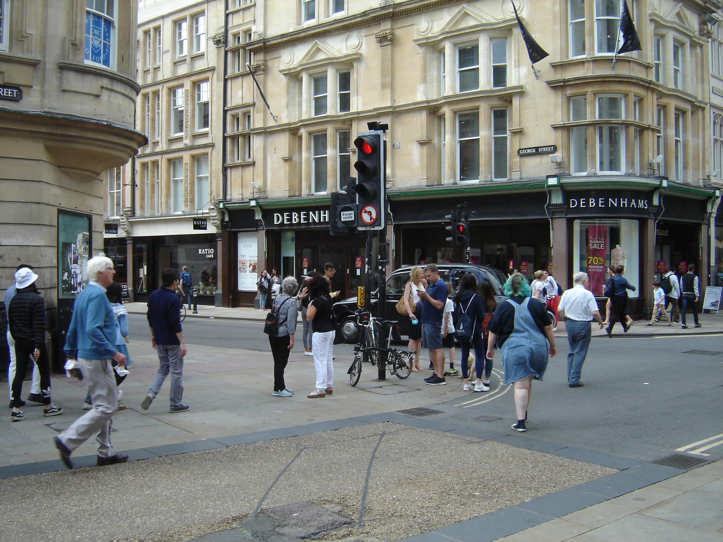 Drab people in Cornmarket crossing George Street, Oxford