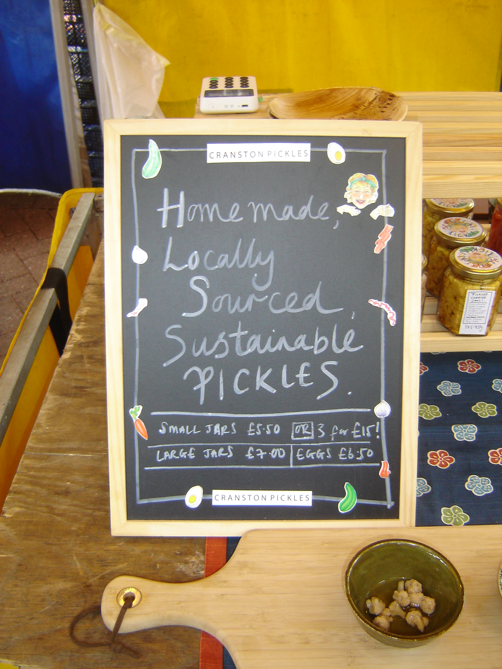 Cranston Pickles chalkboard, reading 'Home-made locally-sourced sustainable pickles'.
