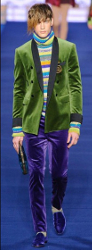 Man wearing purple trousers and light green velvet jacket
