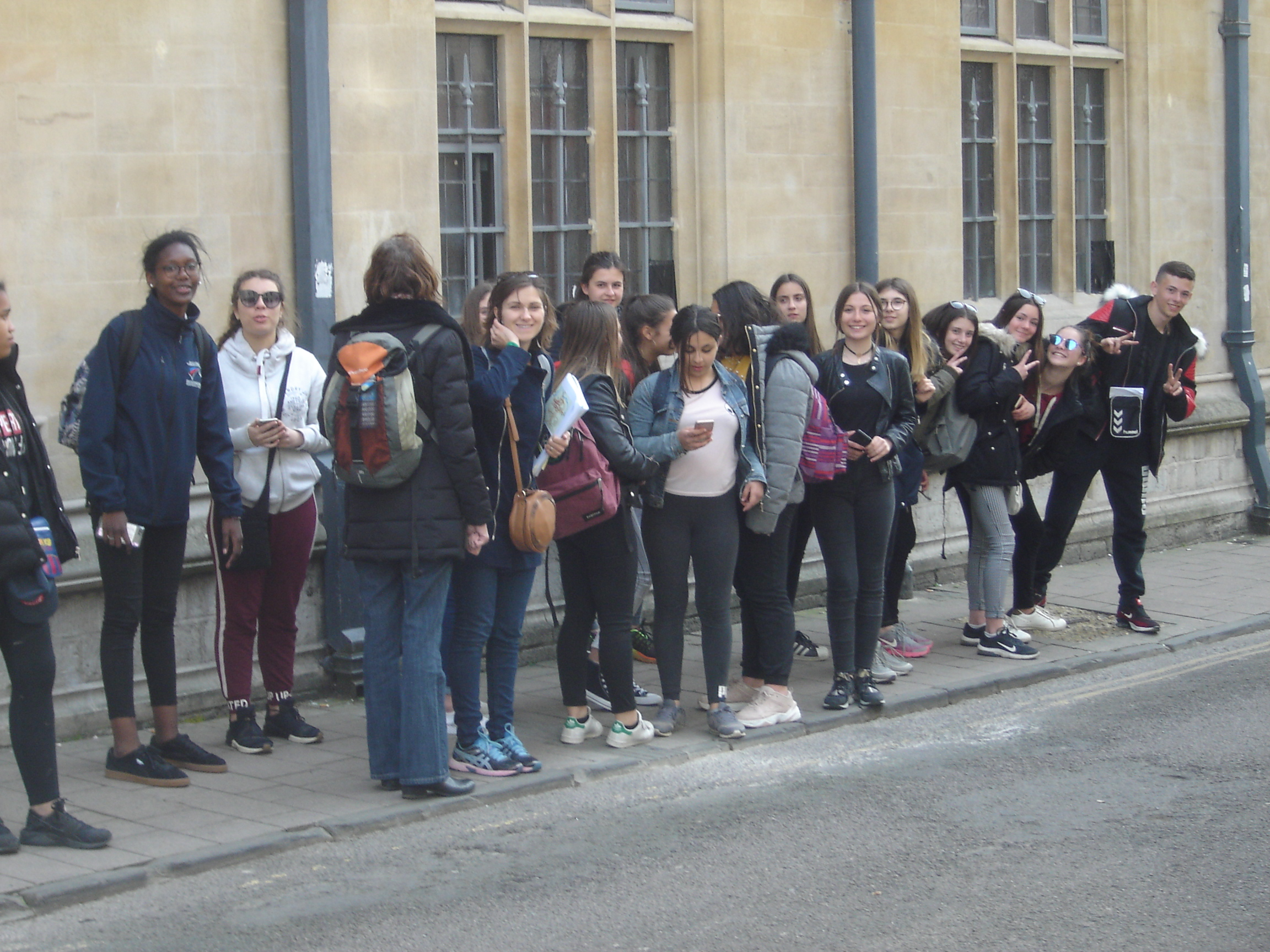 Group of drab tourists in Ship Street, Oxford.