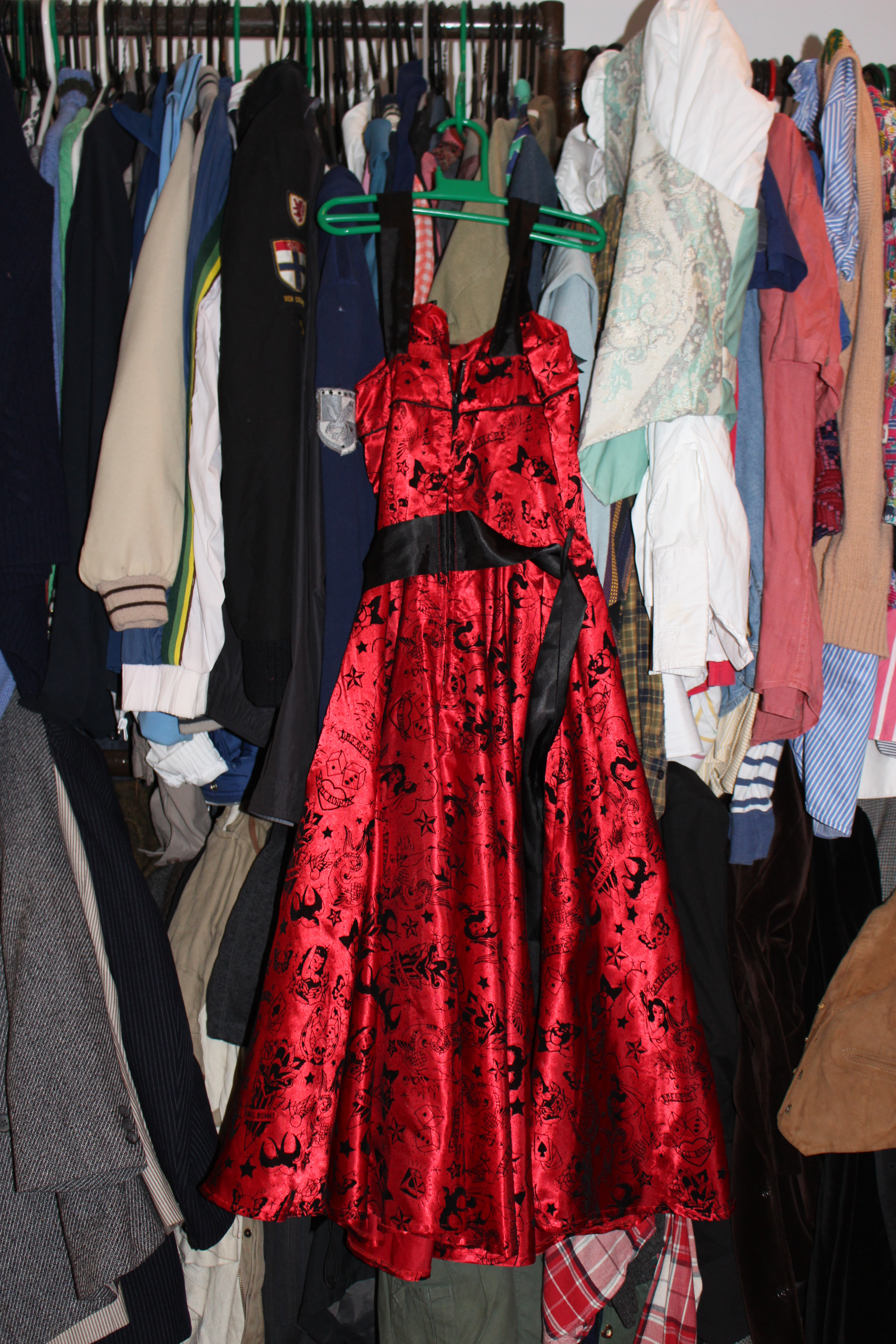 Scarlet satin dress with printed 'devil-dice' motifs