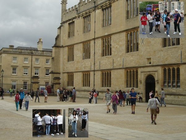 Groups of drab tourists in central Oxford.